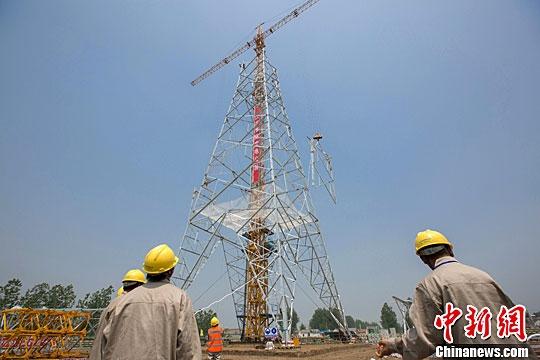 直流输电线路工程铁塔组立首基试点分别在盐城建湖县
