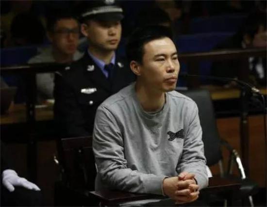 图:王欣在首次庭审上